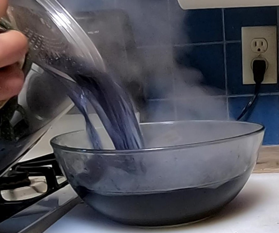 Pouring off red cabbage dye